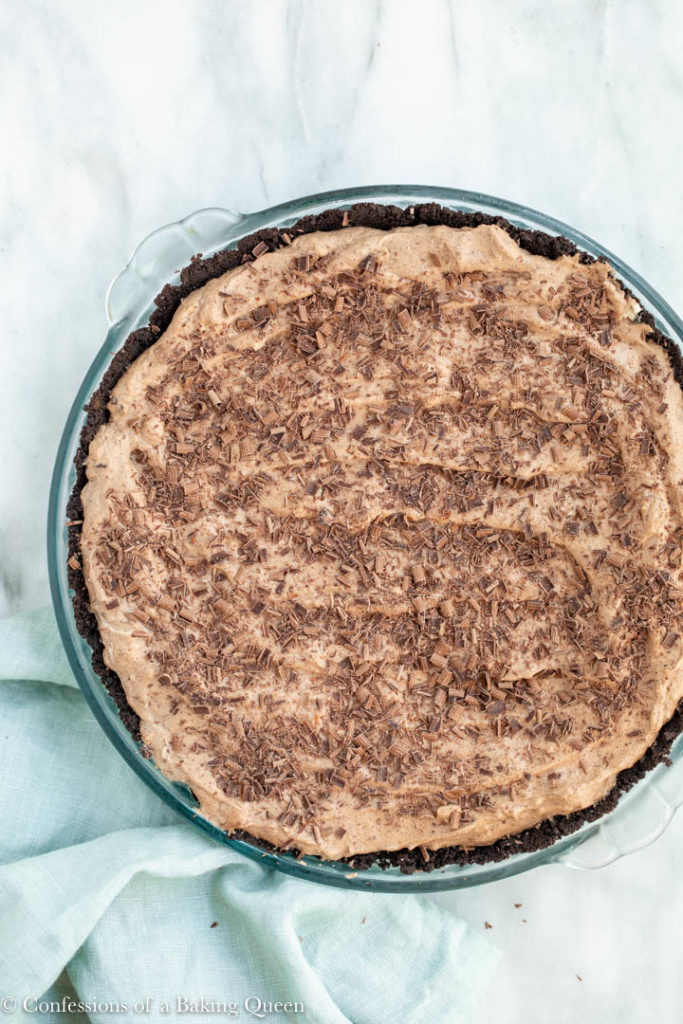 chocolate shavings on top of a nutty irishman pie