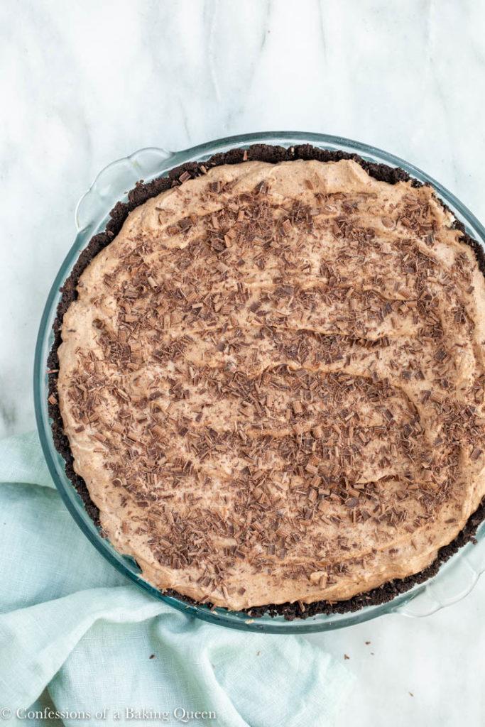 chocolate shavings on top of a nutty irishman pie