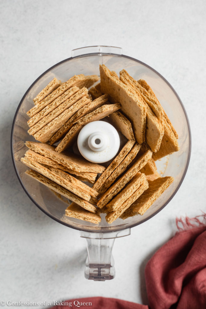 graham cracker pieces in a food processor bowl