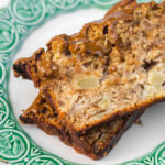 Maple Apple Bread on a white and green plate on a white wood background
