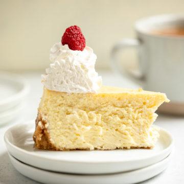 slice of vanilla bean cheesecake on a white plate