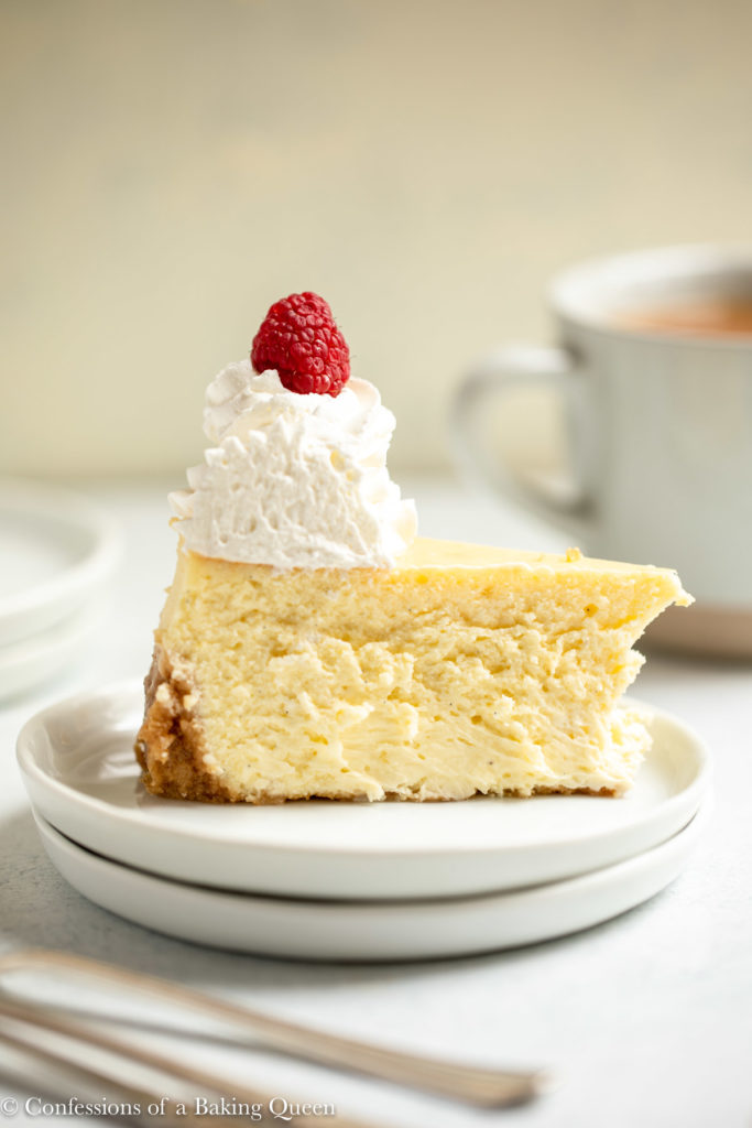 slice of vanilla bean cheesecake on a white plate