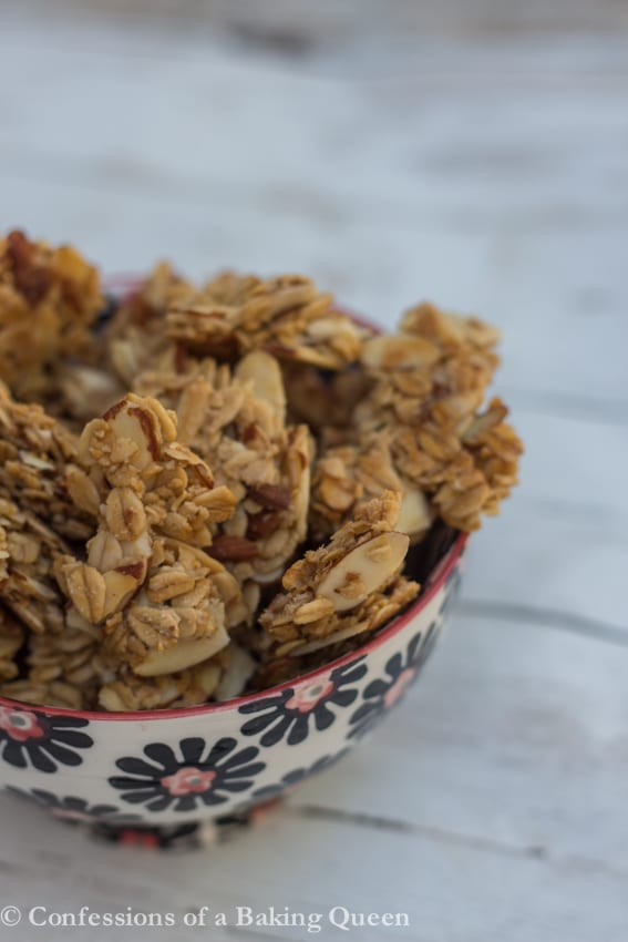 Maple Almond Granola Clusters up close in a white, black and pink bowl