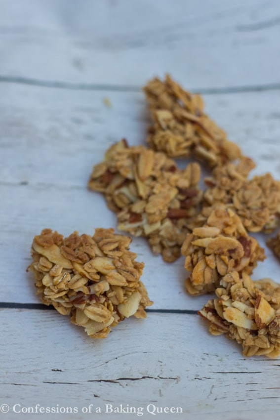 Maple Almond Granola Clusters served on a white wood background