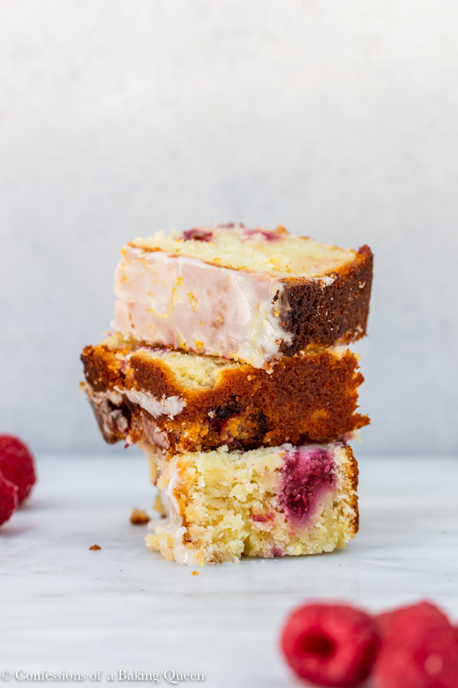 raspberry lemon loaf cake pieces stacked on top of each other