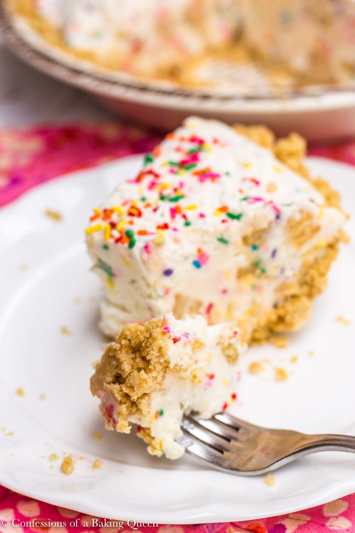 Golden Oreo Cake Batter Ice Cream Pie served on a white plate on a pink linen on a white background