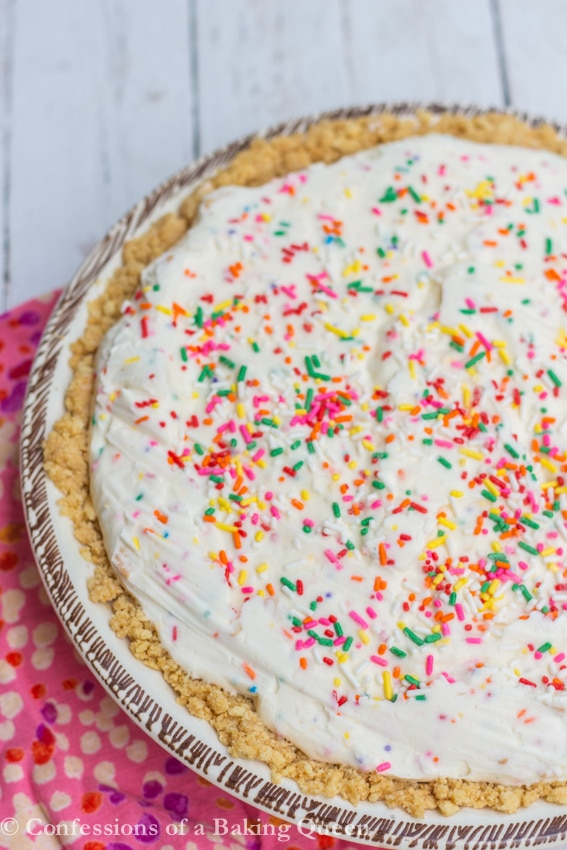 Golden Oreo Cake Batter Ice Cream Pie overhead shot on a white background with pink towel