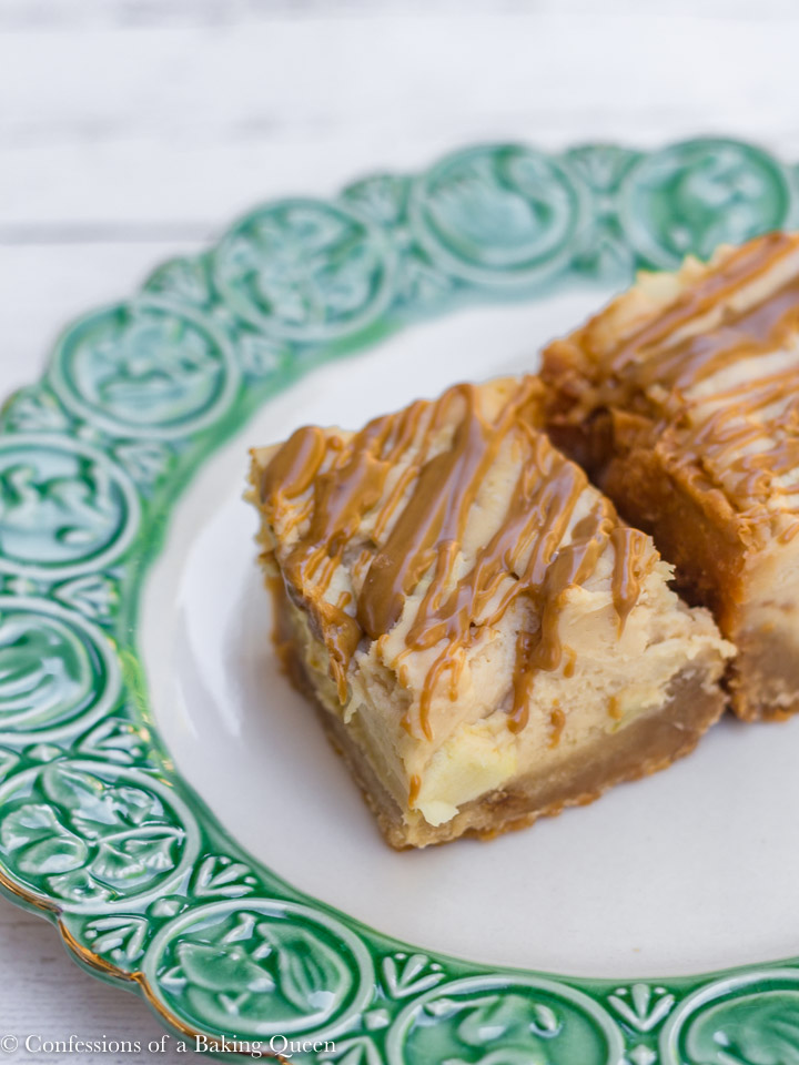 Biscoff Apple Cheesecake Bars on a white plate with green rim