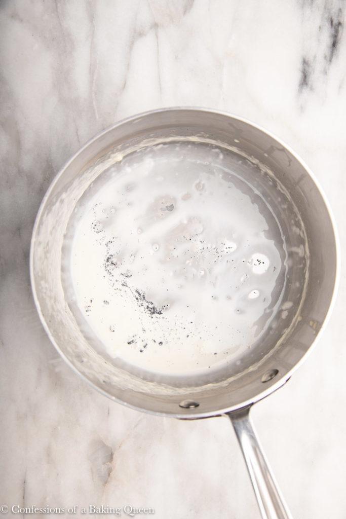 vanilla bean flecks at the bottom of a metal pot