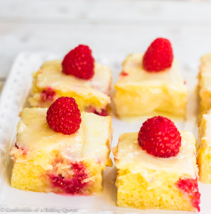 raspberry lemonies cut into squares served on a white plate