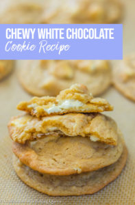 Chewy White Chocolate Cookies stacked on top of each other on a silpat liner