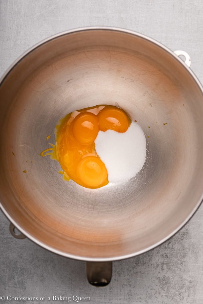 egg yolks and sugar in a metal mixing bowl