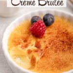 salted caramel creme brulee with a few bites taken out next to a bowl of berries