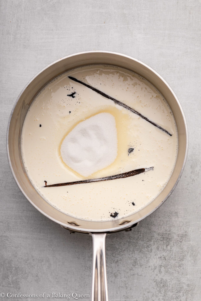 sugar, vanilla beans and pod in heavy cream in a metal pot