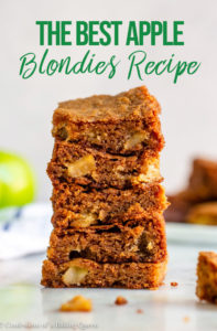 stack of apple blondies on a white marble surface