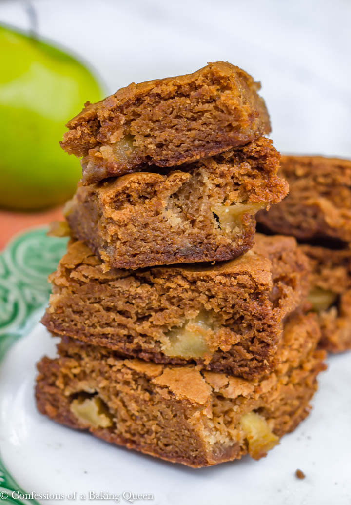 brown sugar apple blondies stacked on top of each other on a white and green plate