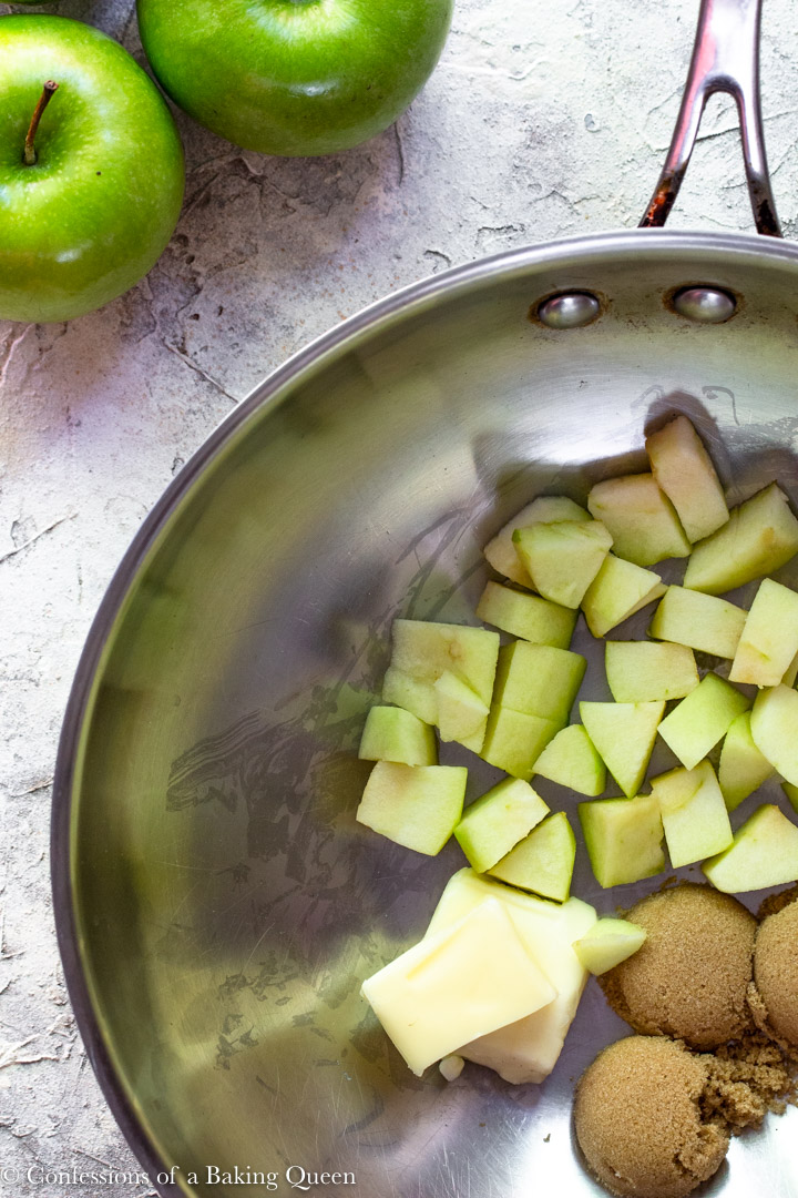 butter, brown sugar and chopped apples in a silver saucepan for an apple blondie recipe