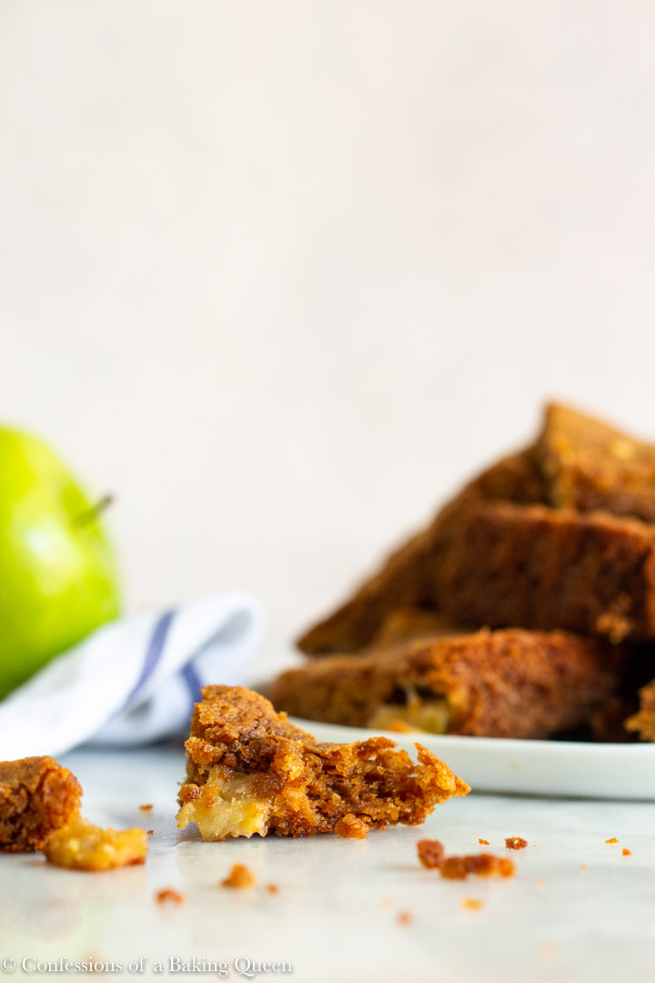 piece of apple blondie torn apart with more blondies in the background