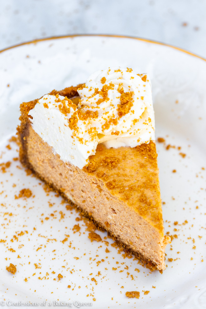 pumpkin cheesecake slice on a cream plate