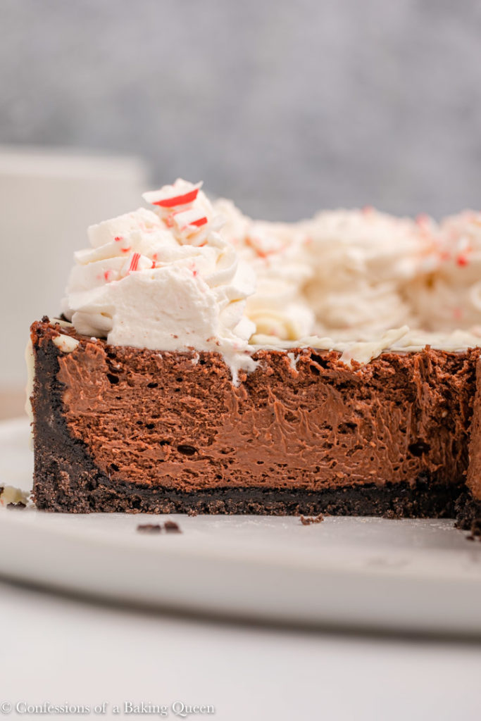 inside of a peppermint chocolate cheesecake on a white plate