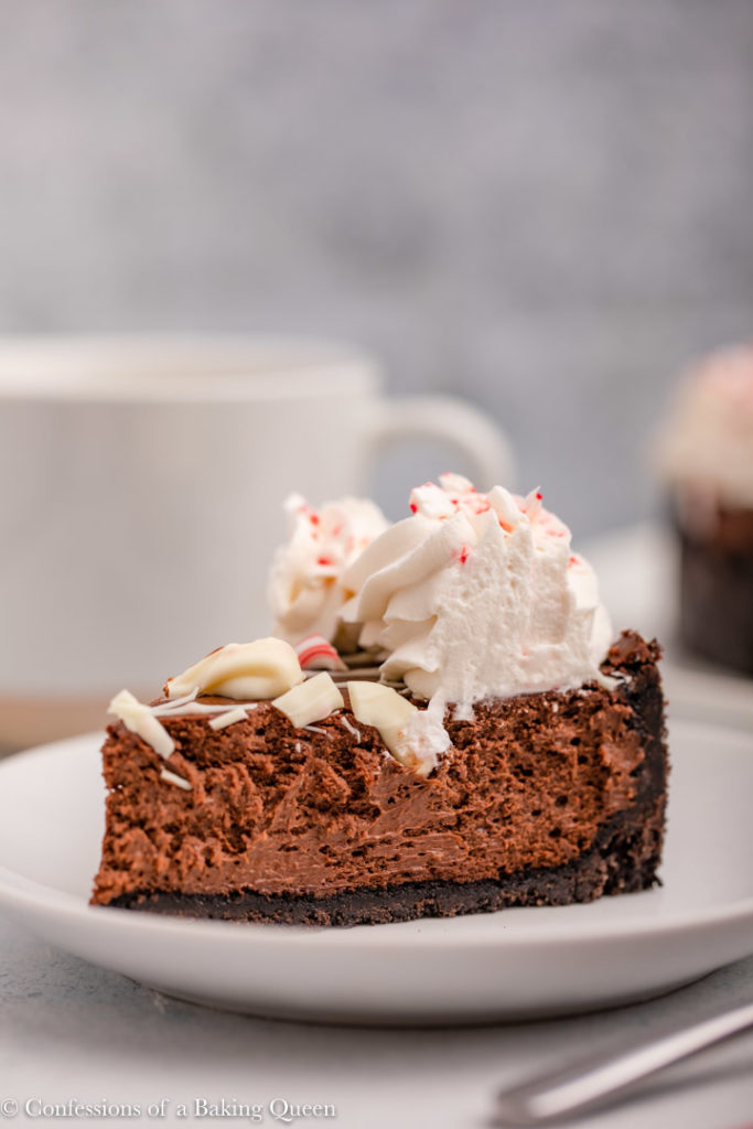 slice of peppermint chocolate cheesecake on a white plate