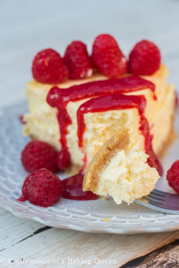 Lemon Cheesecake with Raspberry Sauce www.confessionsofabakingqueen.com