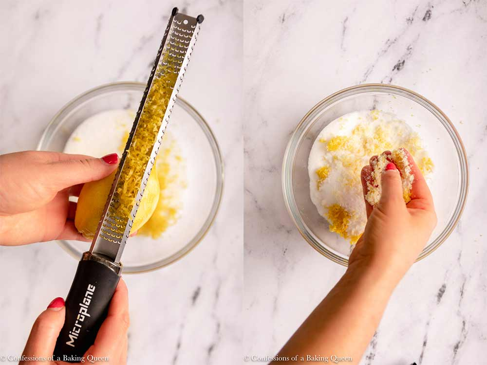 lemon zest added to sugar then hands rubbing the zest into the sugar in a large glass bowl on a marble surface
