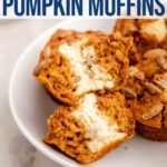 split in half cream cheese pumpkin muffin in a white bowl
