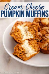 split in half cream cheese pumpkin muffin in a white bowl