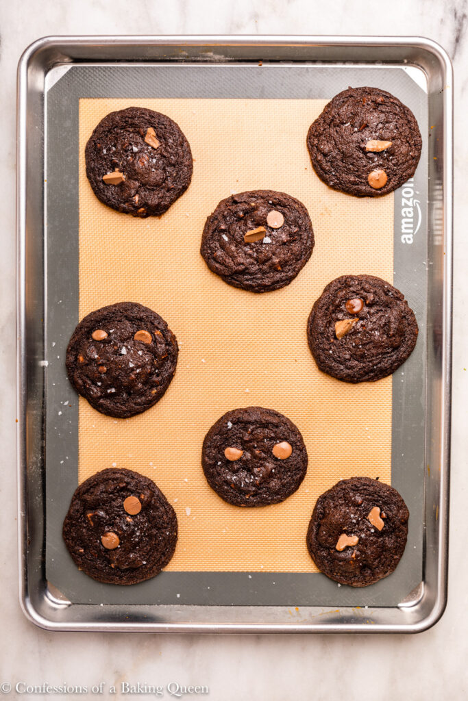 double chocolate cookies just baked on a silpat lined baking sheet