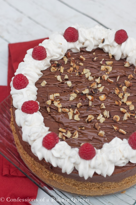 Nutella Cheesecake served on a glass plate with a red napkin on a white background