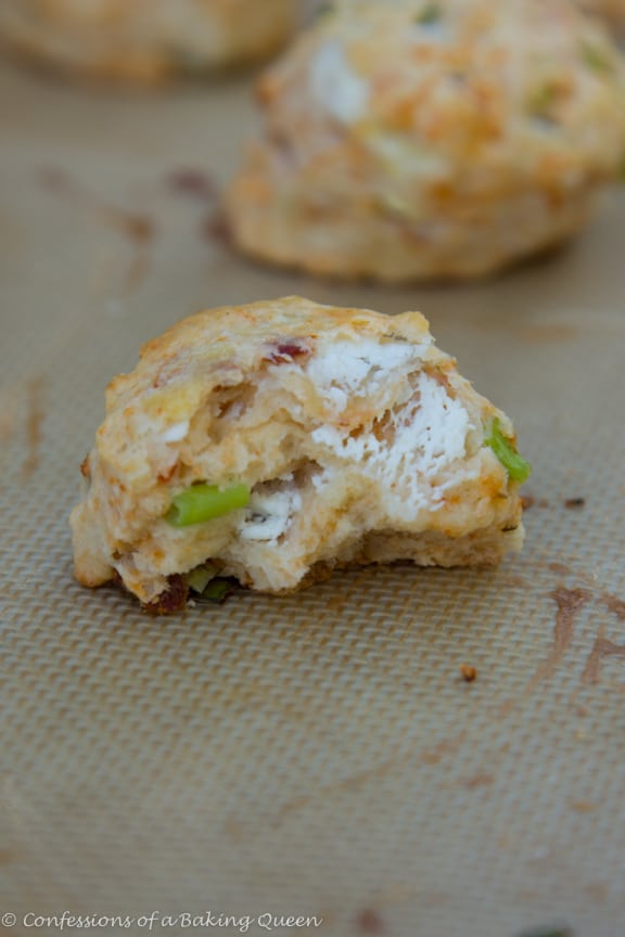 Goat Cheese Chive & Sun Dried Tomato Scones broken in half on a silpat sheet
