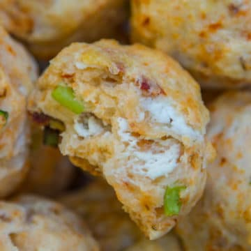 Goat Cheese Sundried Tomato Scones up close surrounded by more scones