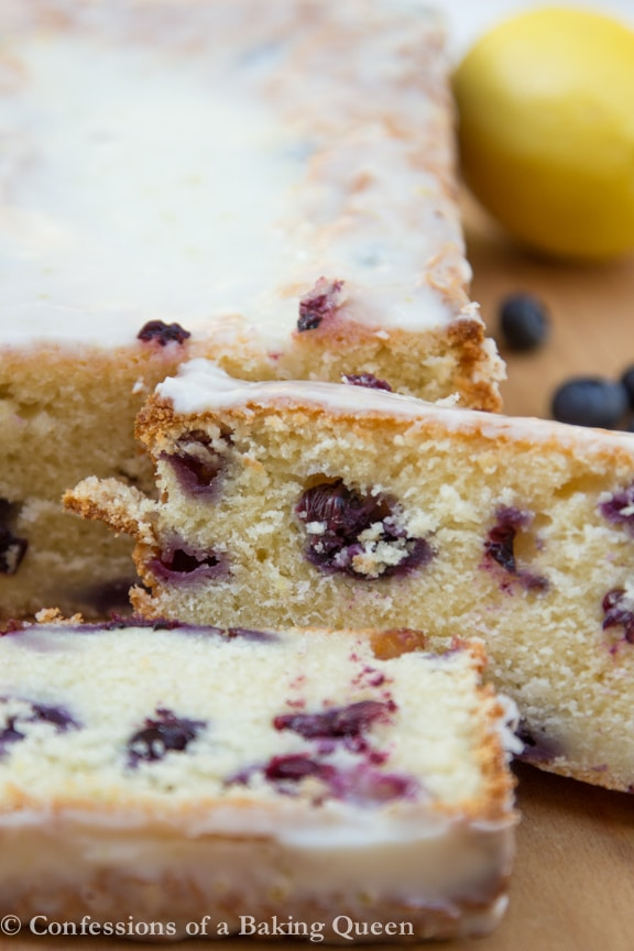 Blueberry Lemon Loaf Cake sliced on a wood cutting board