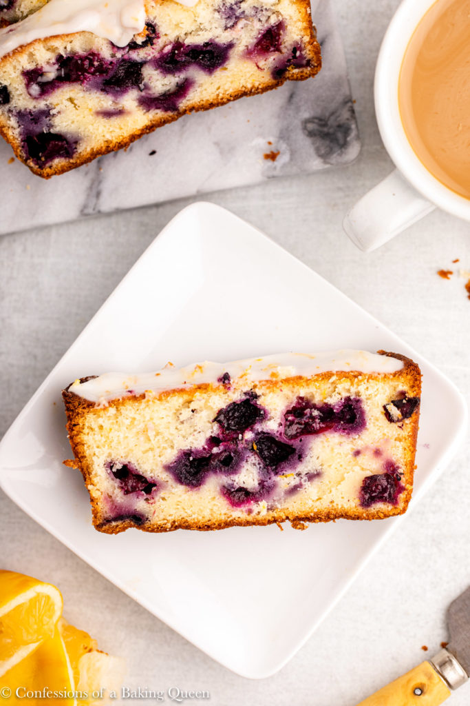 slice of lemon blueberry loaf cake on a square white plate