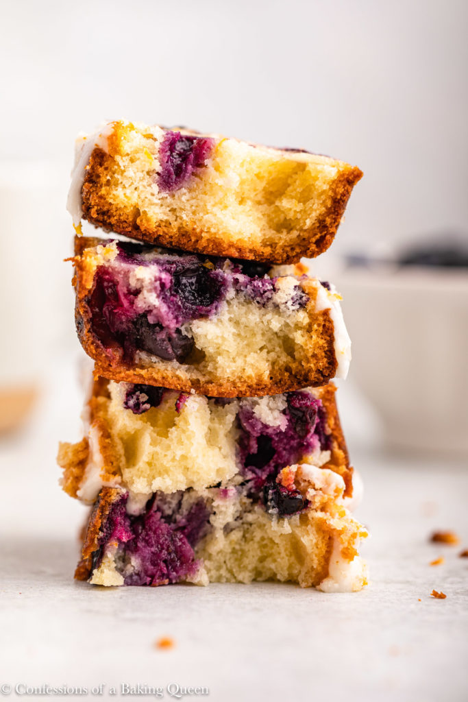 stack of blueberry lemon loaf cake on a white surface