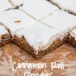 Cinnamon Roll Blondies baked and frosted on parchment paper