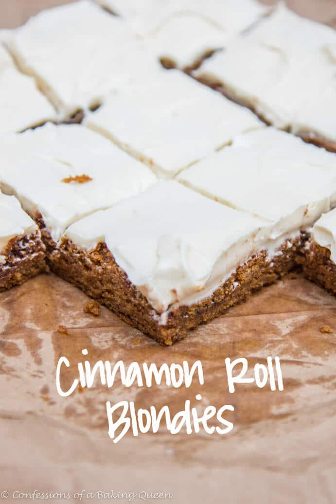 Cinnamon Roll Blondies on brown parchment paper