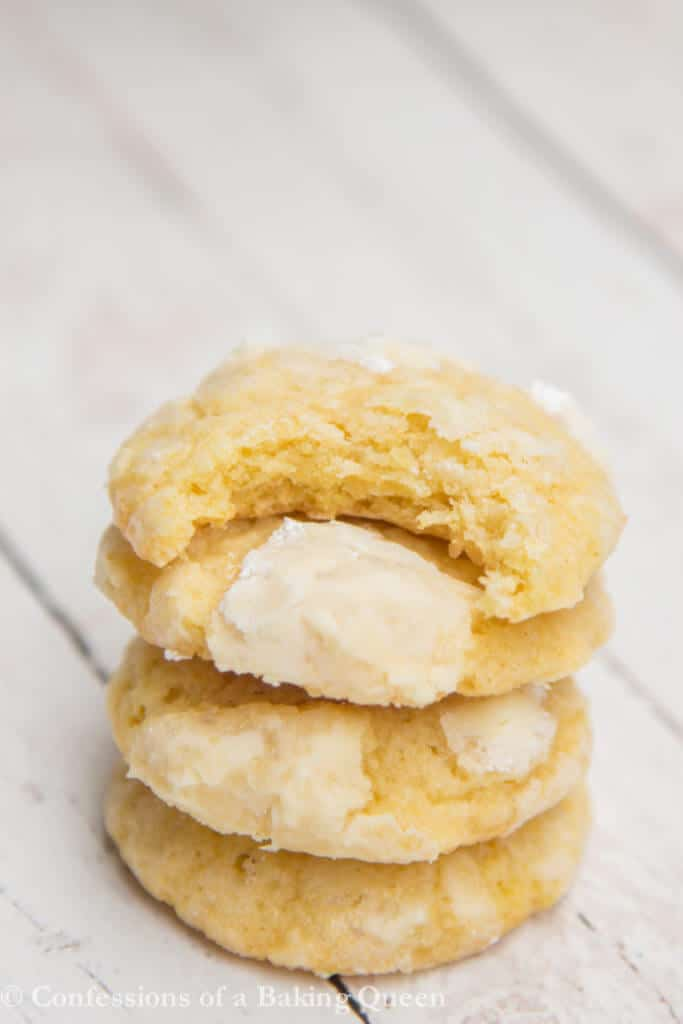 Chewy Lemon Cookies stacked on top of each other with a bite out