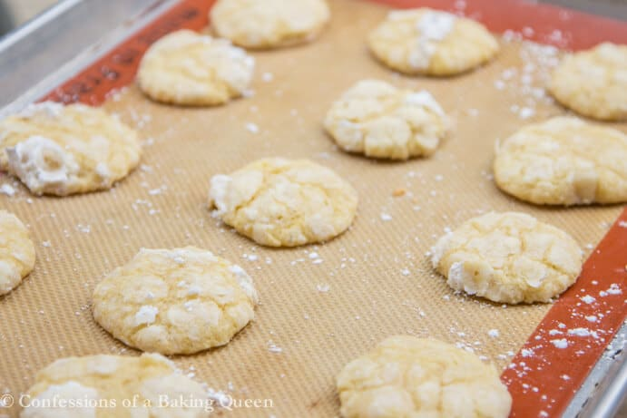 Chewy Lemon Cookies on a silpat lined silver baking tray