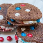 Brownie Cookie Ice Cream Sandwiches on a white plate with m&ms