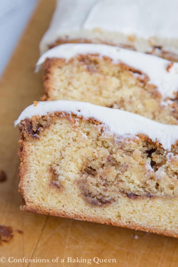 Cinnamon Roll Pound Cake sliced on a wood cutting board