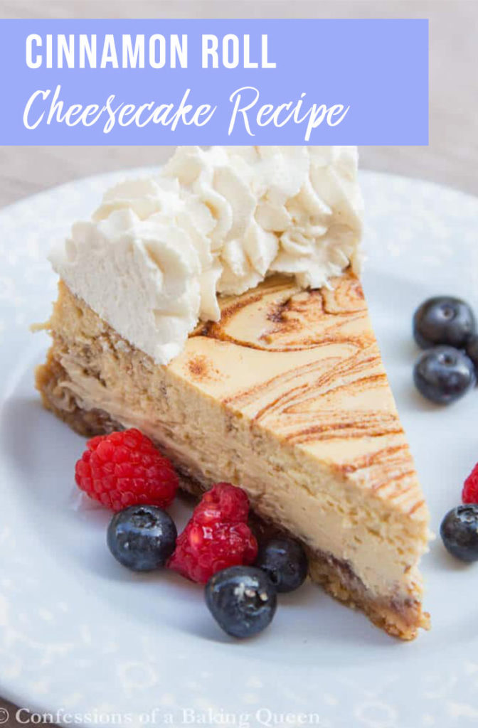 cinnamon roll cheesecake slice on a blue plate with fresh berries