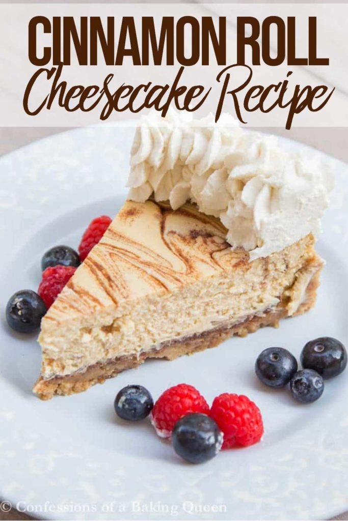 slice of cinnamon roll cheesecake on a light blue plate with berries