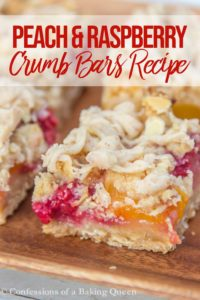 peach and raspberry crumb bars on a wood plate