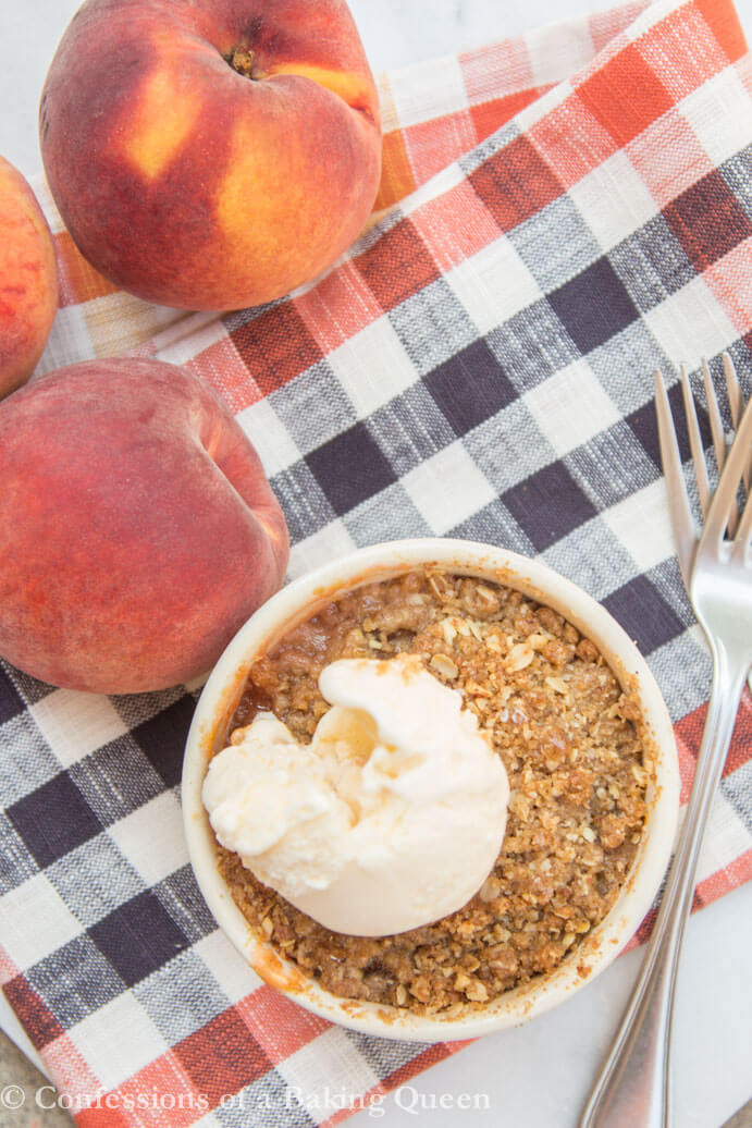 Brown Butter Peach Crumble for Two overhead shot with ice cream on top