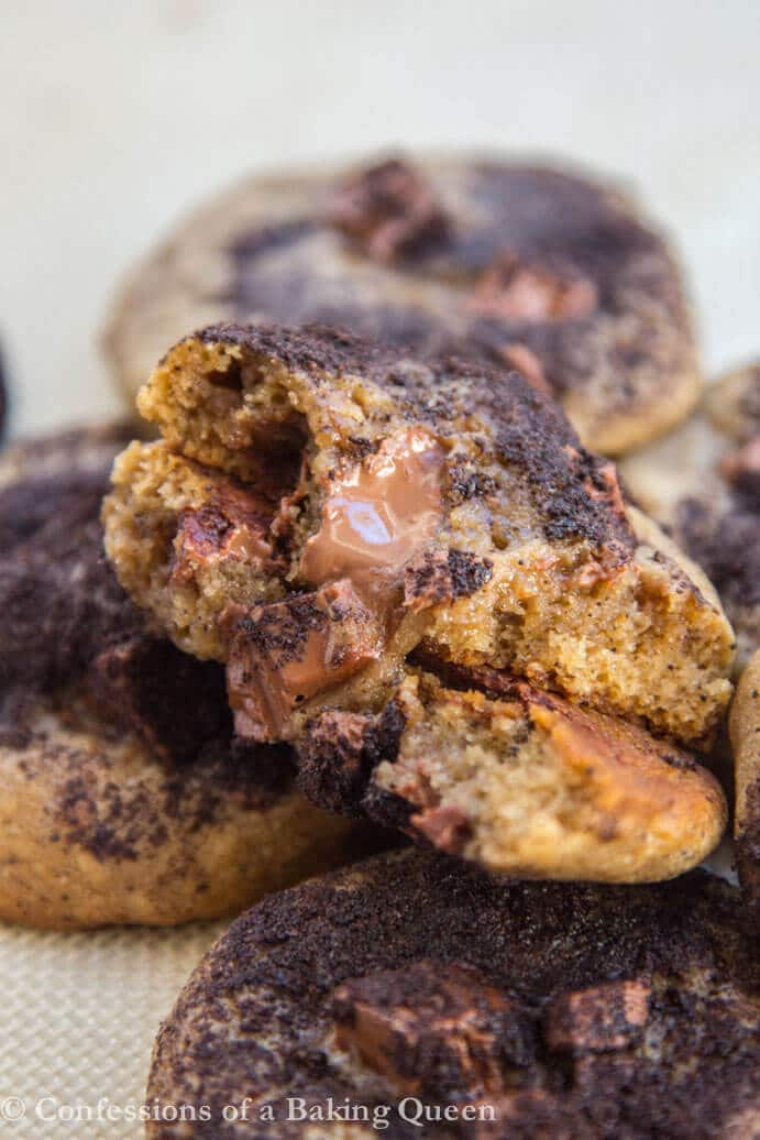 Espresso Chocolate Chunk Cookies with one cookie broken in half