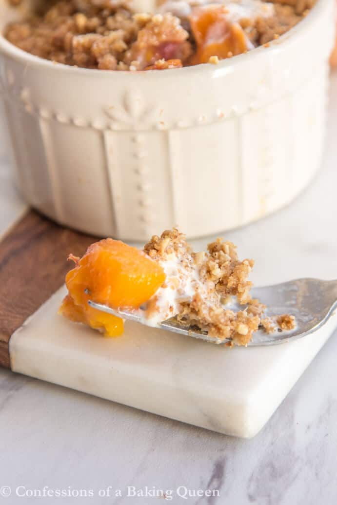 Brown Butter Peach Crumble for Two close up of a bite