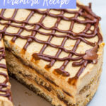 Pumpkin Nutella Tiramisu with a slice missing on a white marble surface