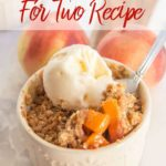 brown butter peach crumble in a cream ceramic dish on a wood and marble board